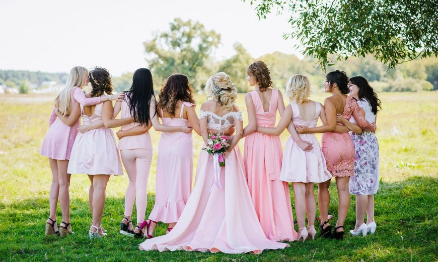 bride and bridesmaids dressed in soft pink