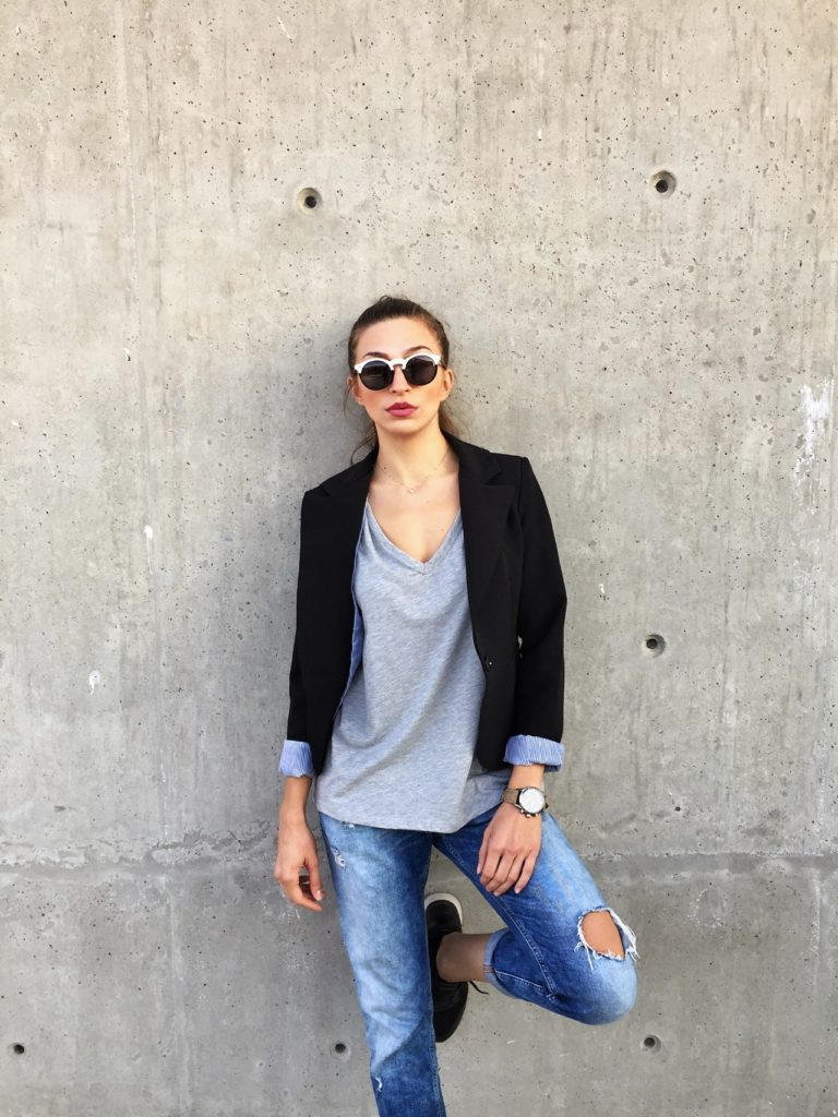 woman in a blazer and denim