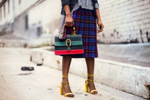 woman in a plaid skirt