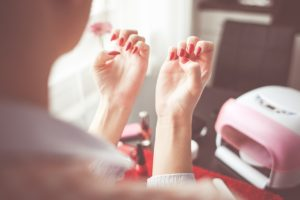 woman enjoys her manicure