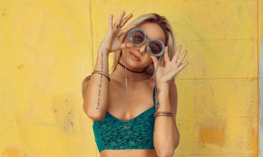 girl wearing round sunglasses