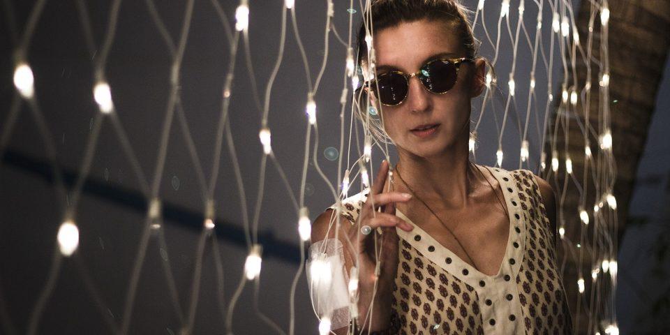 woman wearing round sunglasses