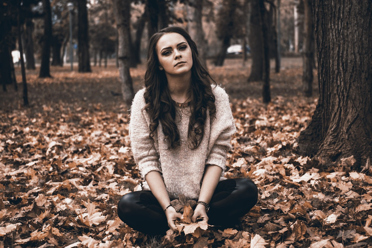 girl sitting on the leaves