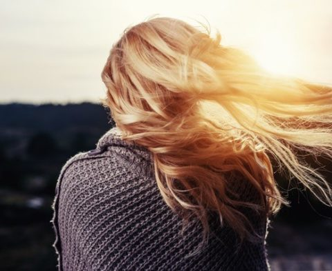 blonde hair on a windy day
